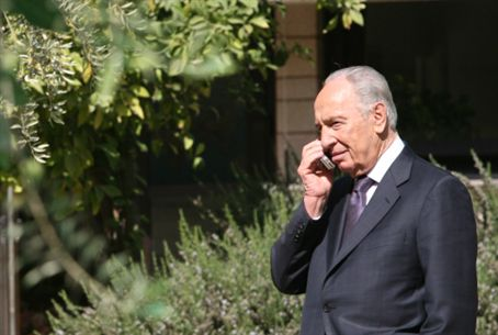 President Shimon Peres on cell phone