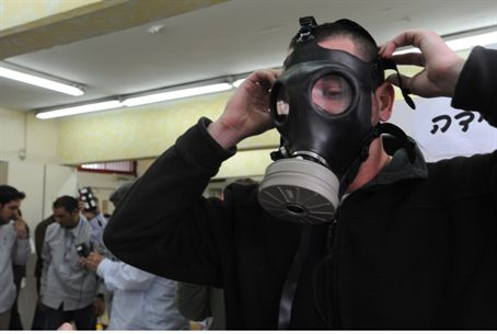 Man tries on gas mask