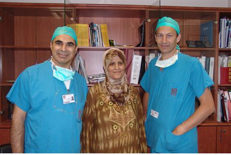 Rambam doctors with the patient they saved