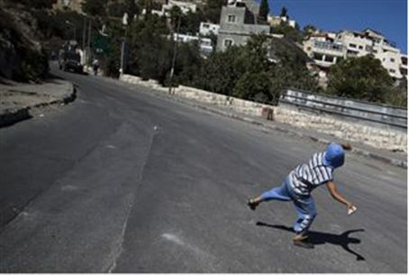 Jerusalem Arab boy throws stone