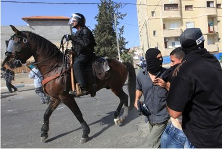 Mounted police disperse rioters