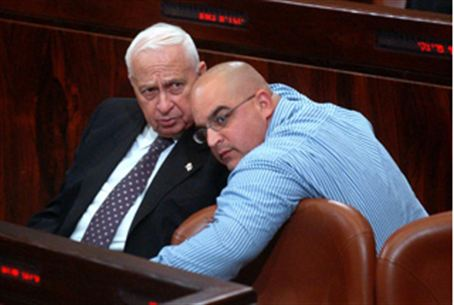 Former PM Sharon (left) with son Omri