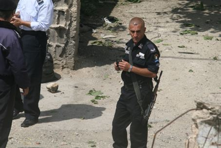 Armed Arab policeman - seen from Hadassah Hou