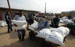 Gaza residents pick up food supplies