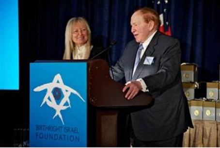 Adelsons at a Birthright reception