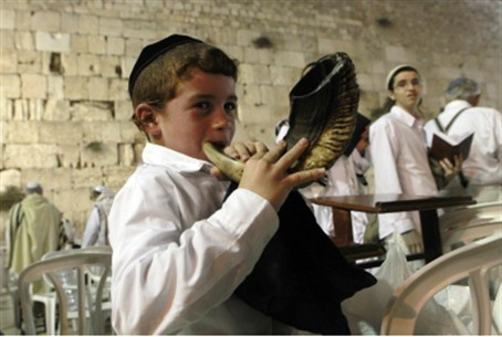 Pint-sized shofar blower at the Kotel.