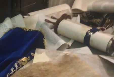 Torah scrolls thrown on the floor in Hemed
