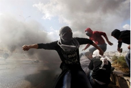 Masked Arab rock throwers