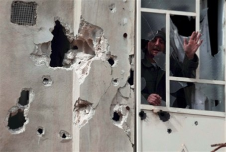 A man shouts from window afterr shelling by A