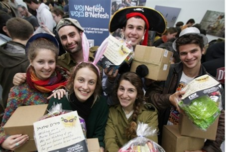 Purim New olim prepare Purim gifts for lone s