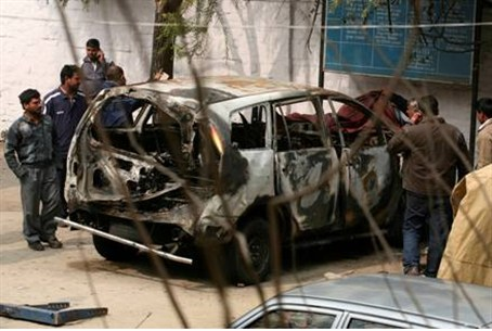 Remains of car in bomb attack in India bomb