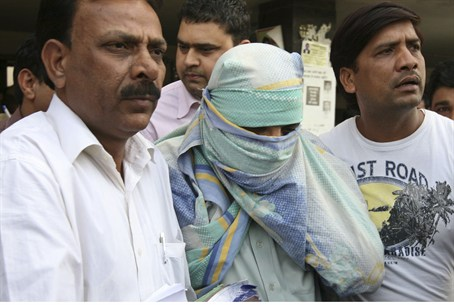 Ahmed Kazmi with face covering
