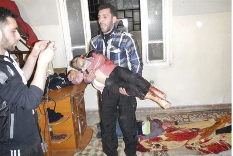 Man Carrying Body of Child in Homs, 12 March