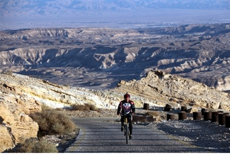 Bicycling with Dead Sea in background