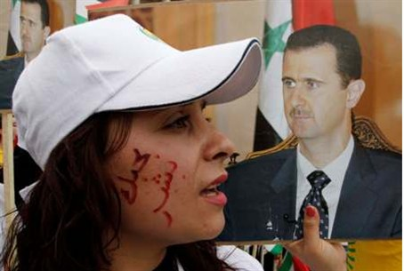 A supporter with words 'Bashar I love you' on