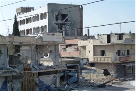 Buildings hit by government forces near Homs