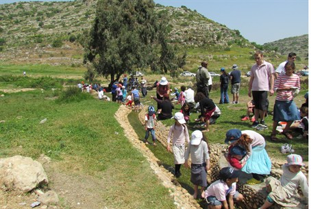 Visitors hike in Samaria