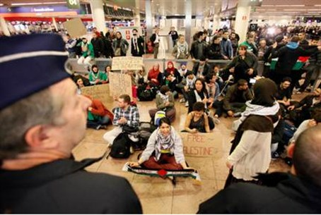 Activists stage a protest at Brussels nationa