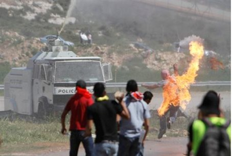 PA Arab throws firebomb at Israeli forces.