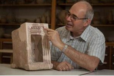 Prof. Yosef Garfinkel with a stone shrine mod