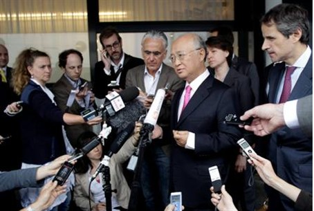Yukiya Amano briefs the media after his trip