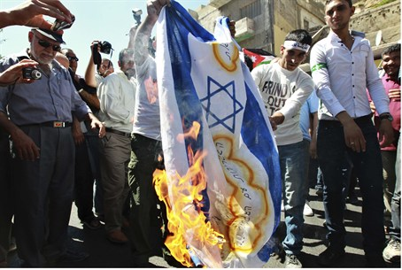 Protesters burn Israeli flag