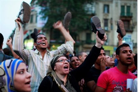 Protesters wave their shoes at Tahrir Squar