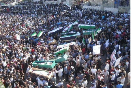 Syrians carry bodies of people protesters sai