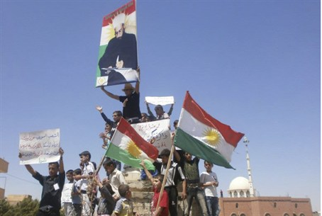 Demonstrators hold Kurdish flags