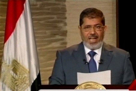 Morsi speaks during his first televised addr