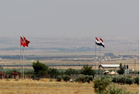 Turkish and Syrian flags are seen on the Turk