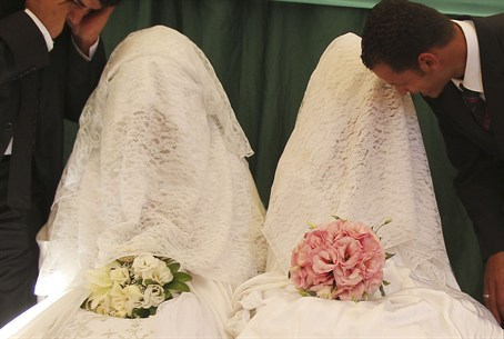 Arab brides speak to their grooms during a ma