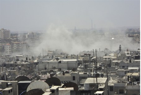 Smoke rises from village enear Homs