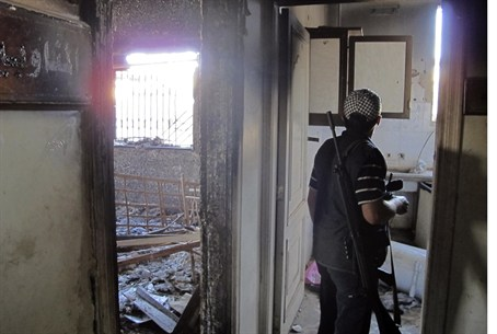 FSA soldier checks building in Aleppo provinc