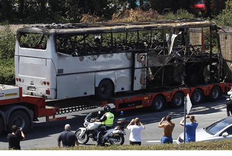 Removing remains of attacked bus