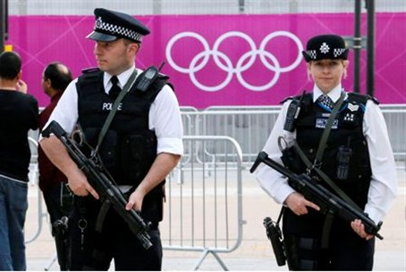 British police officers patrol outside the Lo