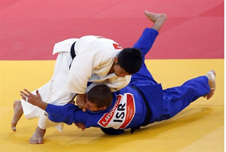 Japan's Hiroaki Hiraoka fights with Israel's