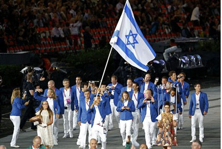 Israel's flag bearer Shahar Zubari holds the