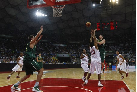 Lithuania's Martynas Pocius (R) goes for a ba