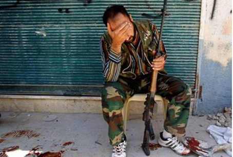 Free Syrian Army fighter  after his friend wa