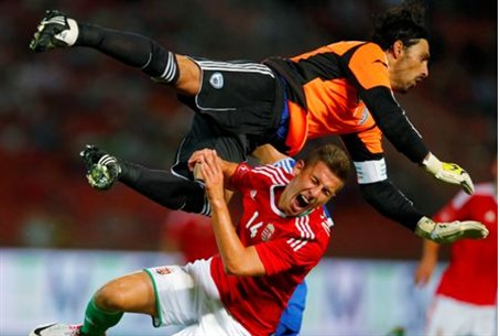 Hungary's Krisztian Nemet (front) fights for