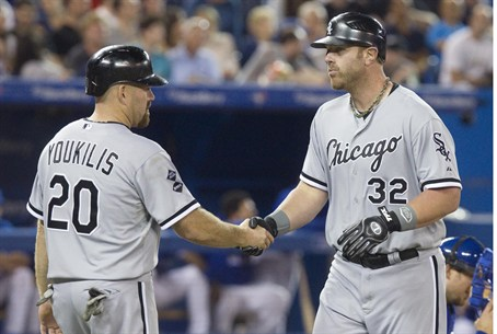 Chicago White Sox Adam Dunn (R) is congratula