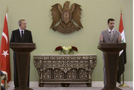 File photo of Assad and Erdogan at a news con