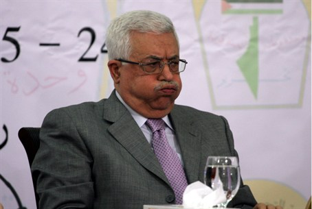 Abbas with map of 'Palestine'Palestine' in ba