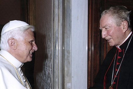 File photo of Pope Benedict XVI shaking hands