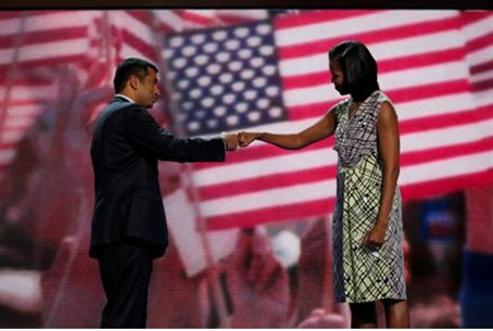 Michelle Obama 'fist-bumps' actor and Obama a