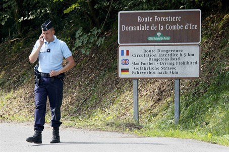 French gendarmes block access to a road to La