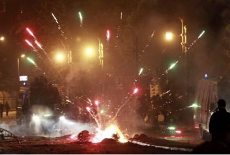 Fireworks explode as protesters clash with ri