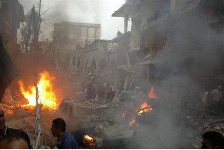 Syrians inspecting the site of a car bomb att