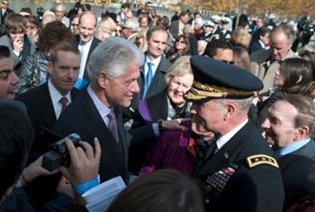 Clinton greets visitors during the opening c